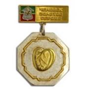 Золотые значки — сувениры элитного уровня фото
