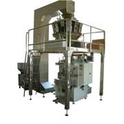 Упаковочный автомат с комбинированным электронным весовым дозатором. фото