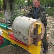 Дровокол гидравлический . Применяется для очистки улиц от сваленных деревьев и облегчает вывоз древесины с места расчистки. фото