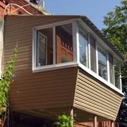 Реконструкция и остекление балконов и лоджий фото