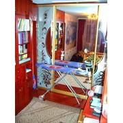 Шкаф-купе со встроенной гладильной доской фото