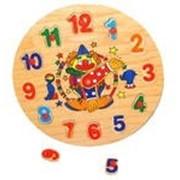 Детские деревянные развивающие часы пазл-клоун. фото
