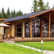 Финский дом из оцилиндрованного бревна фото