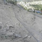 Ликвидация последствий ЧС природного характера, а именно текущий ремонт и укрепление скальных откосов автодороги «Медеу-Шымбулак» фото