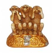 Три обезьяны на золоте фото