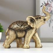 """Сувенир полистоун """"Золотистый слонёнок с пальмовыми листьями на попоне"""" 17,5х7х19 см фото"""