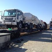 Отправка спецтехники и автомобилей из Владивостока по жд, услуги по приемке и выгрузке грузов фото