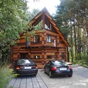 Деревянные дома из оцилиндрованного бревна технической сушки. фото