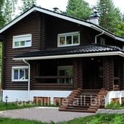 Деревянный загородный дом из бревна 227 м² фото