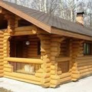 Срубы домов с установкой на участке Заказчика, зимний лес. фото