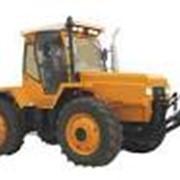 Услуги по обработке земли: уборка трактором фото