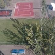Укладка покрытия Хард, грунт (Теннисит), искусственная трава фото