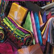 Услуги по Дублированию тканей через поролон 2-5 мм. ширина до 2 м/п. Проклейка Флизелина Дублерина. Услуга по Триплированию ткани. Холодное склеевание для обувного производства ( изо. материалов). фото