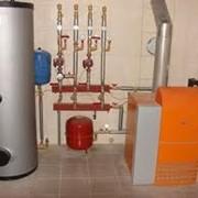 Монтаж систем отопления в Киеве фото
