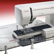 Промышленная и бытовая швейная машины фотография