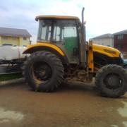 Уборка снега трактором. Трактор для уборки снега. фото